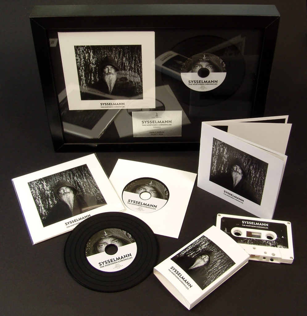 Presentation frame with vinyl CDs and cassettes