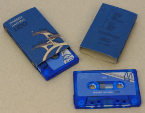 Transparent blue cassettes in printed brown Manila recycled O-cards