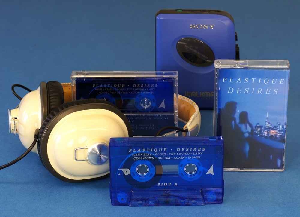 Tranparent blue cassette shells with silver on-body printing, packed in clear cases with full colour J-cards
