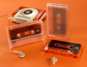 Transparent orange cassette tapes with tracing paper inserts