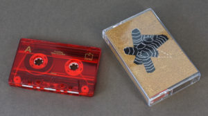Transparent red cassettes with gold on-body printing and matching J-cards