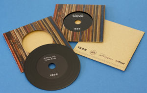 A set of black vinyl CDs in printed card brown Manila record-style wallets