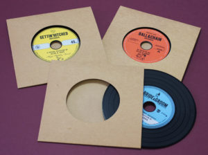 A set of three different black vinyl disc designs for a wedding