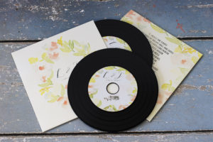 Wedding CDs in recycled card wallets