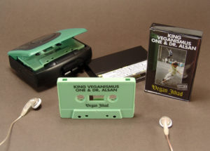 Sage green cassette tapes in black cases with additional J-card panels