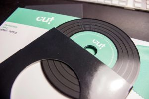 Box set of four premium vinyl CDs in printed outer wallets and plain black inner record-style wallets