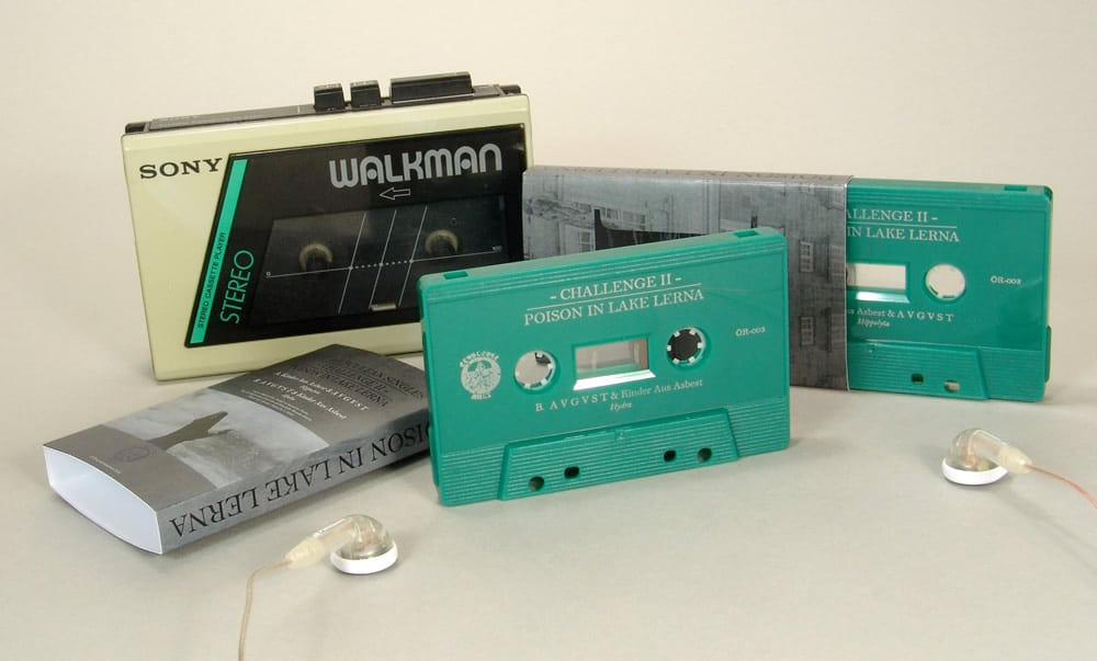 Jade green cassettes with silver on-body printing in printed O-cards
