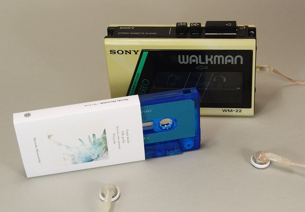 Transparent blue cassettes with sticker printing and matt O-cards