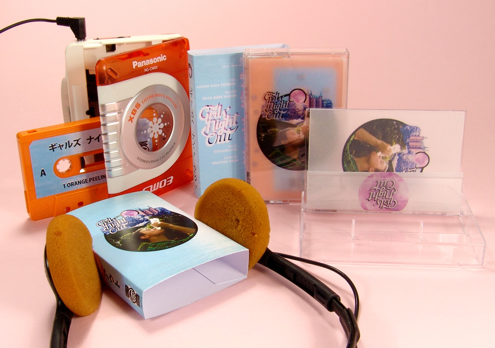 Tangerine cassettes in clear cases with clear vellum J-cards and outer oversized O-cards