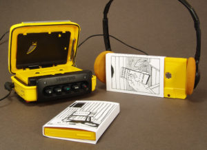 Unprinted yellow cassettes in black and white printed O-cards