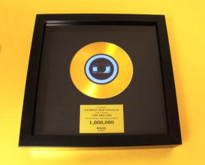 Gold vinyl CD in frame for George Dervenagas