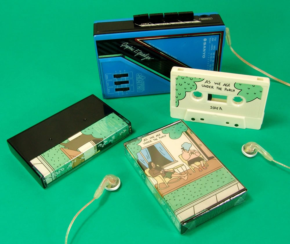 Cream cassette tapes in black cases with printed J-cards and then cellophane wrapped