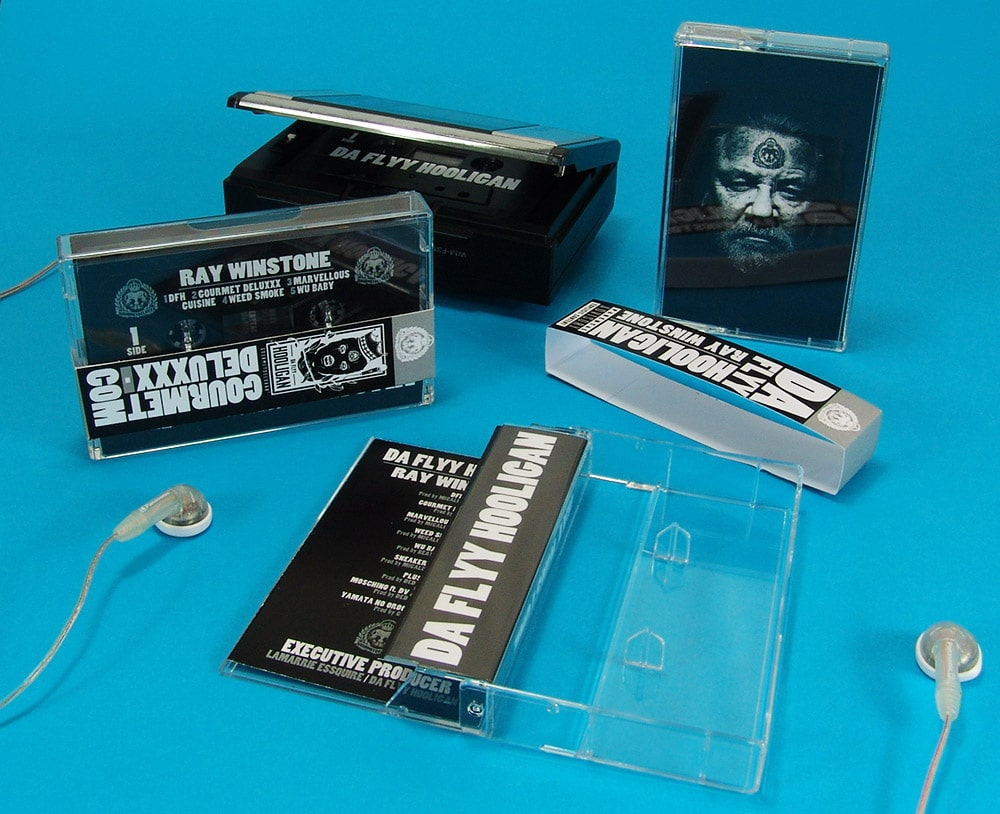 Black cassettes with sticker printing in cases with J-cards and obi strips