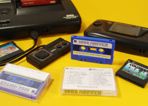 Sega Forever audio cassette tape with stickers and J-cards in clear cases
