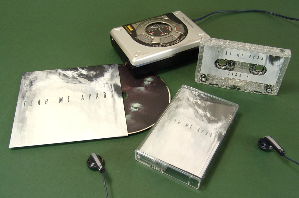 Silver glitter cassette tapes with matching CDs in printed card wallets