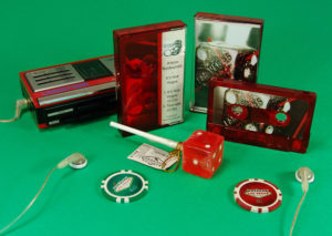 Transparent red cassettes in transparent red back cassette cases
