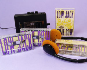 Metallic gold liner cassettes with purple full coverage UV LED printing and eco-natural recycled cardstock J-cards