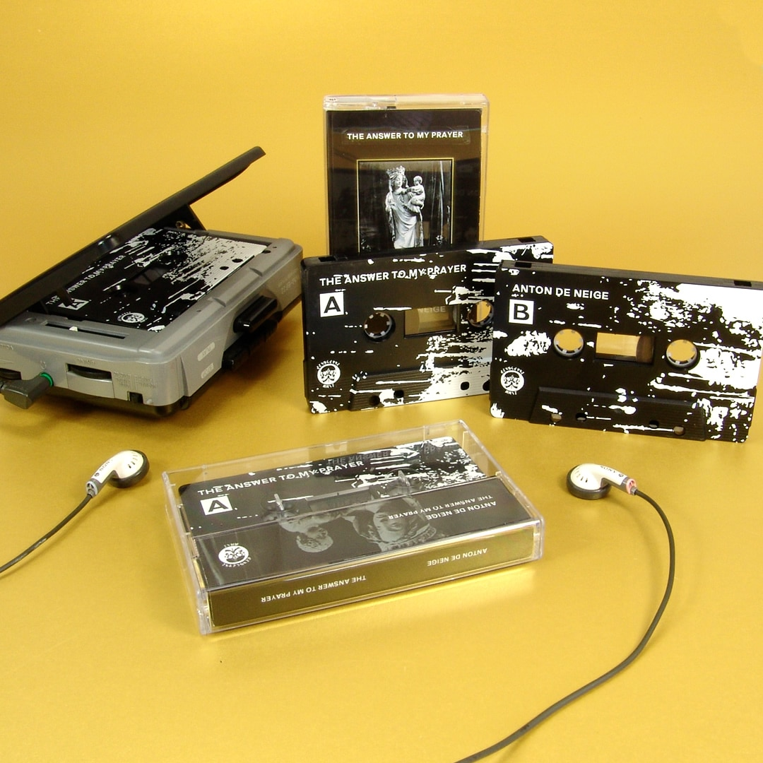 Black cassette tapes with white full coverage 'splatter' style printing