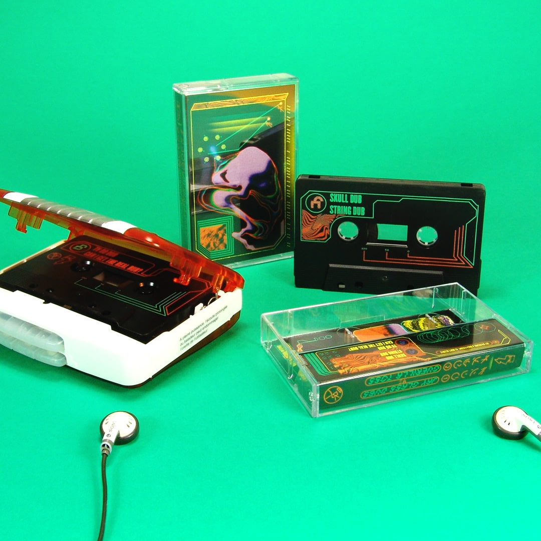 Black cassettes in standard cases with green and orange on-body printing