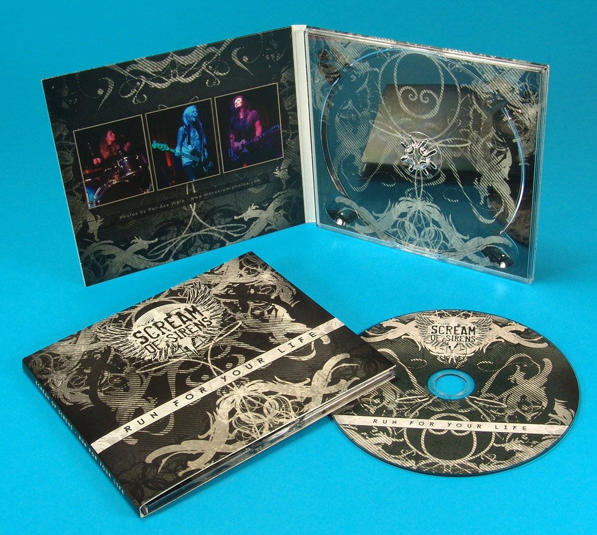 Four page CD digipak with UV LED printed discs