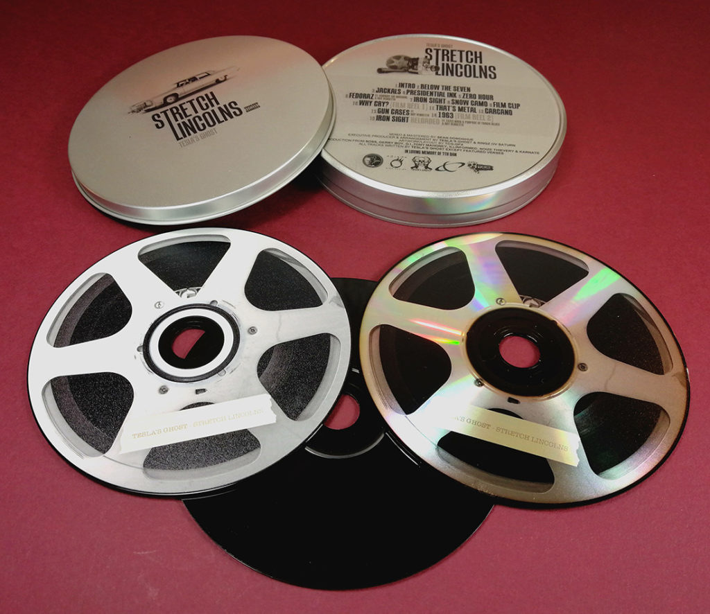 CD tins with top and base printing, plus black base discs with on-body printing