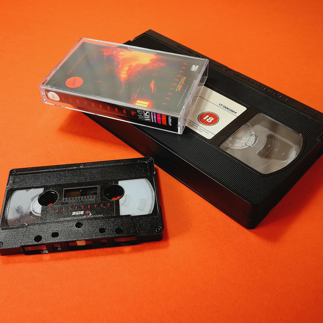 Black audio cassettes with full coverage UV LED printing to give the effect of an old VHS tape