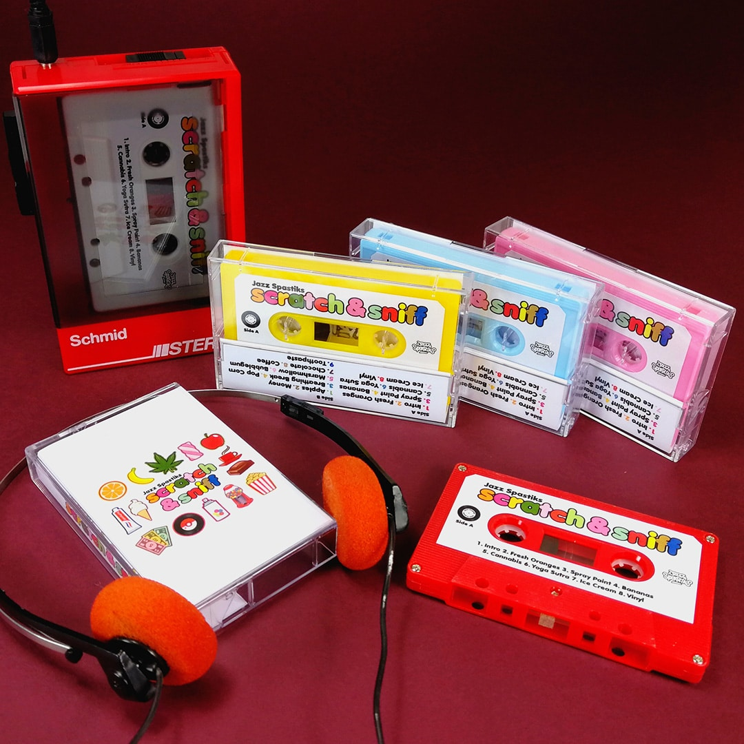 Colourful cassettes with book containing a unique scratch & sniff scent for each track!