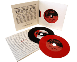 Two vinyl CDs in double record-style wallets