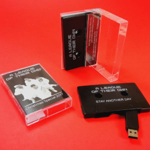 Black cassette tape USB memory sticks in cases with J-cards