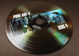 Custom printed vinyl CD with a picture under the grooves and a white print on top of the grooves