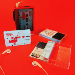 Baby blue cassette shells with UV LED full coverage printing and packed in clear cases with J-cards