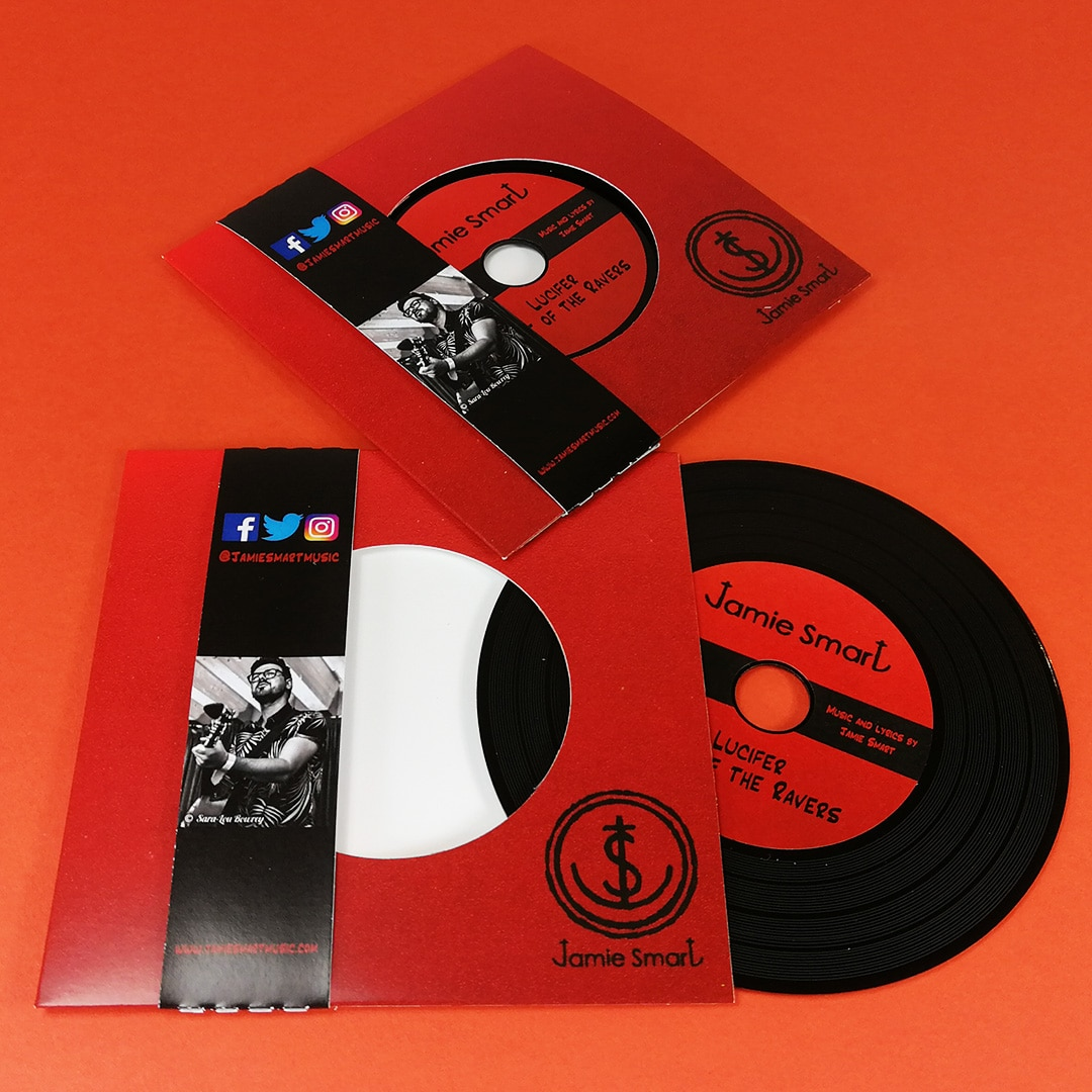 Black vinyl CDs in record-style wallets with obi strips