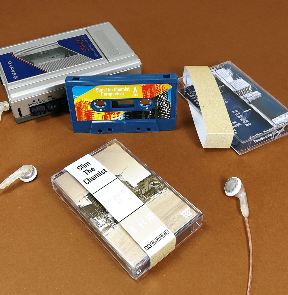 Petrol blue cassette tapes in clear cases with obi strips