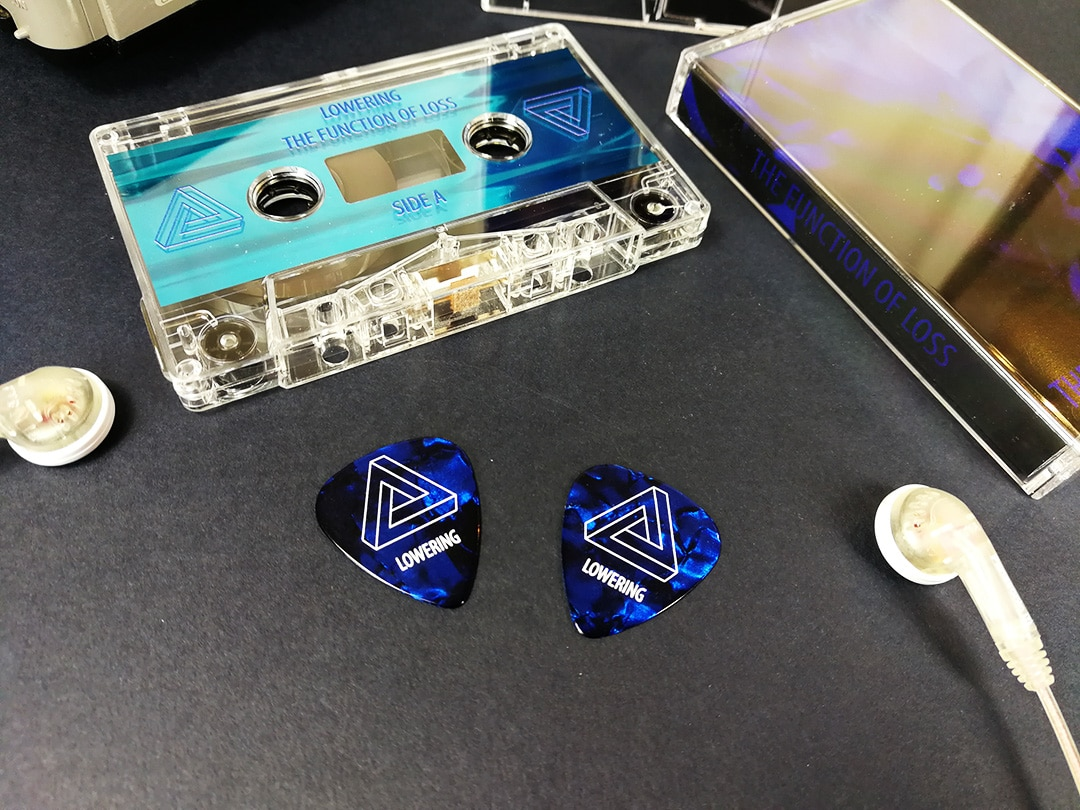 Dark blue guitar picks to match the on-body artwork of a cassette release
