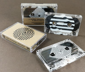 Clear tapes with silver liners and a full coverage white UV-LED print, plus printed brown Manila J-cards