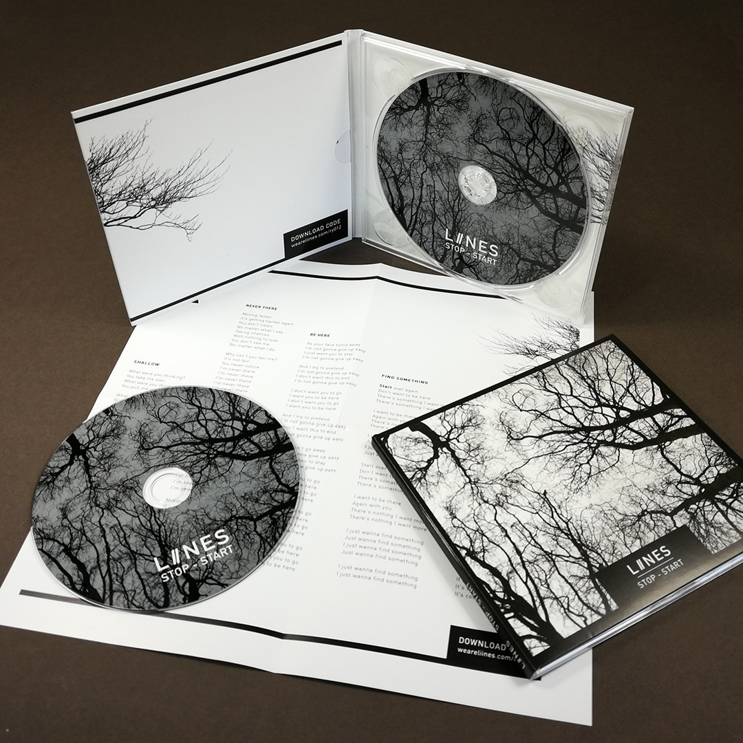 Four page CD digpaks with eight page fold-out posters and litho printed discs