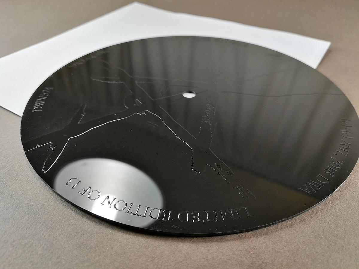 "7"" vinyl records with spot gloss UV LED printing on the reverse"