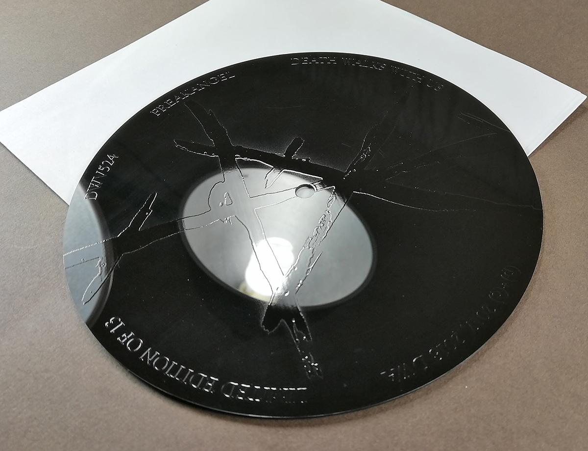 "Spot gloss printing on the reverse of a 7"" record"