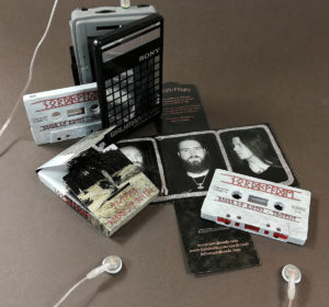 Grey cassettes with full coverage UV-LED on-body printing, in full colour printed Maltese cross boxes