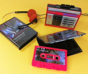 Hot pink cassette tapes with sticker printing and packed in black rave cases