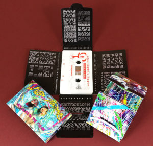 White cassette tapes with sticker printing, packed in full colour printed Maltese-cross packs