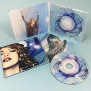 CDs with spot gloss printing in printed 4 page digipaks with 16 page booklets