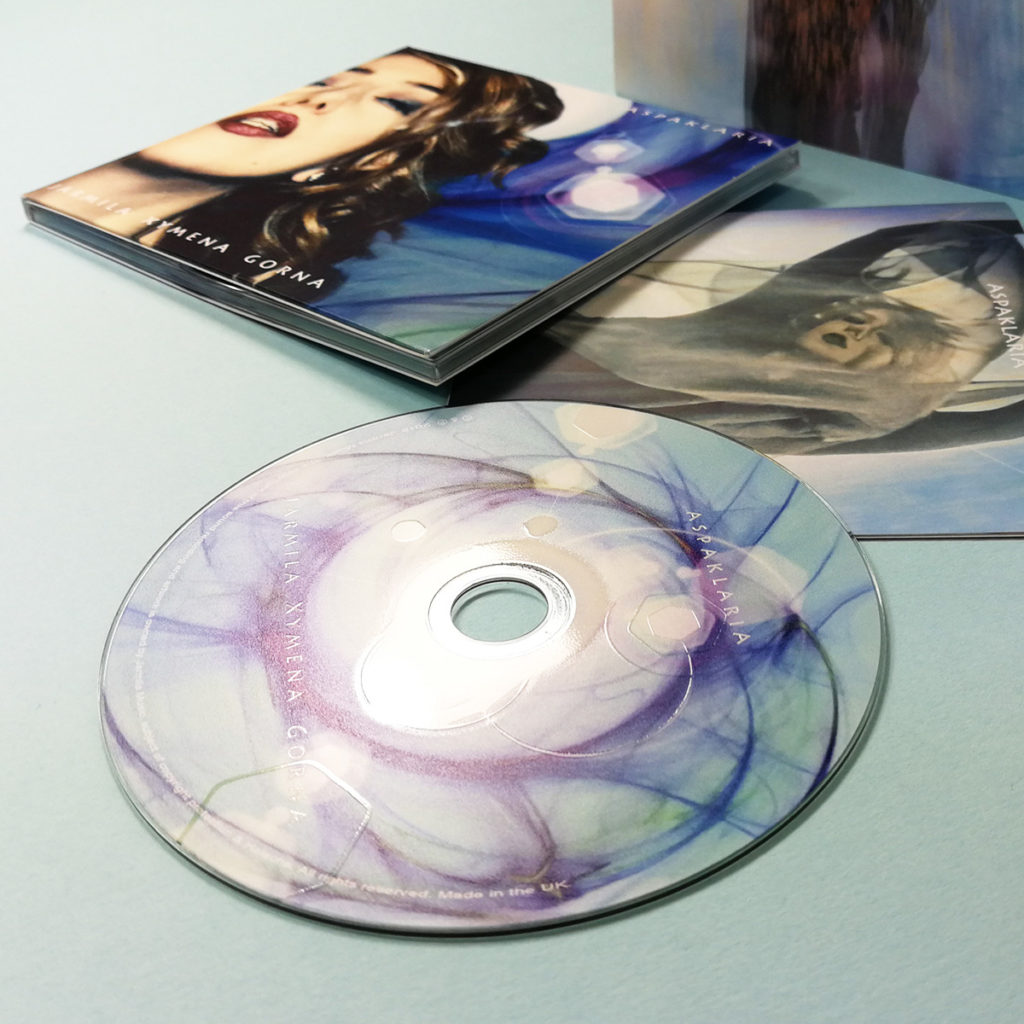 Spot gloss printed CDs in 4 page digipaks with 16 page booklets