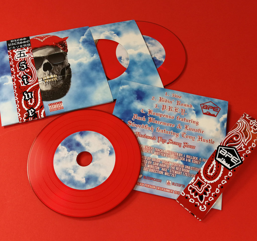 Red vinyl-style CDs in printed premium wallets with record-style inners and obi strips