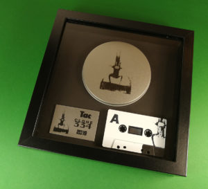 Printed cassette tape, metal plaque and tin lid