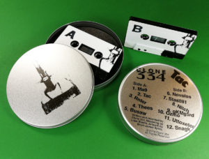 Black tapes with full coverage white on-body printing in printed metal tins