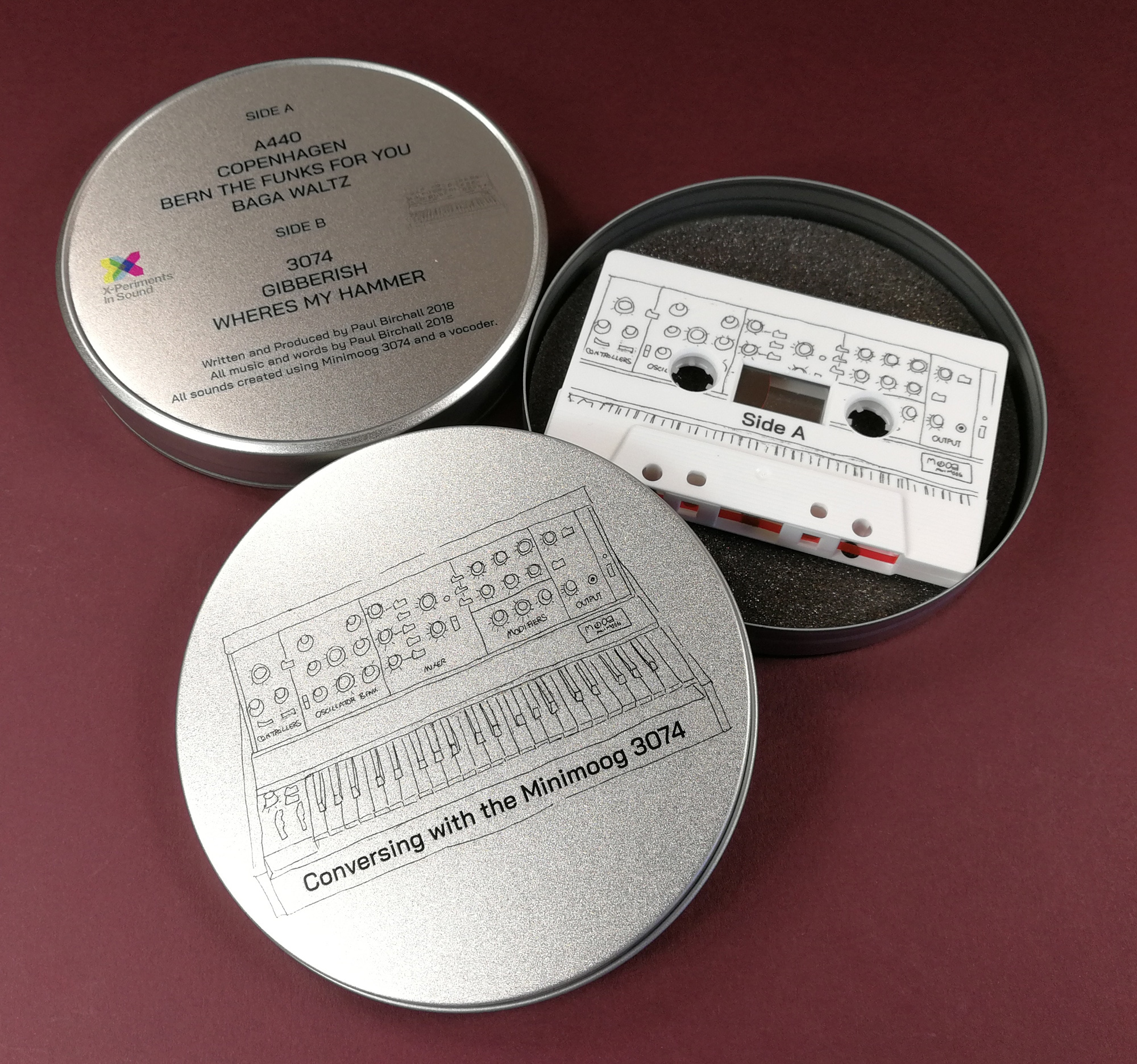Lid and base printed cassette tape tins with on-body printing on the tapes