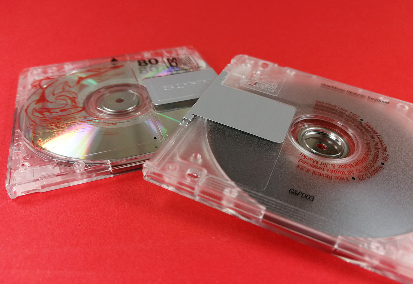 Clear MiniDiscs with red and black on-body printing