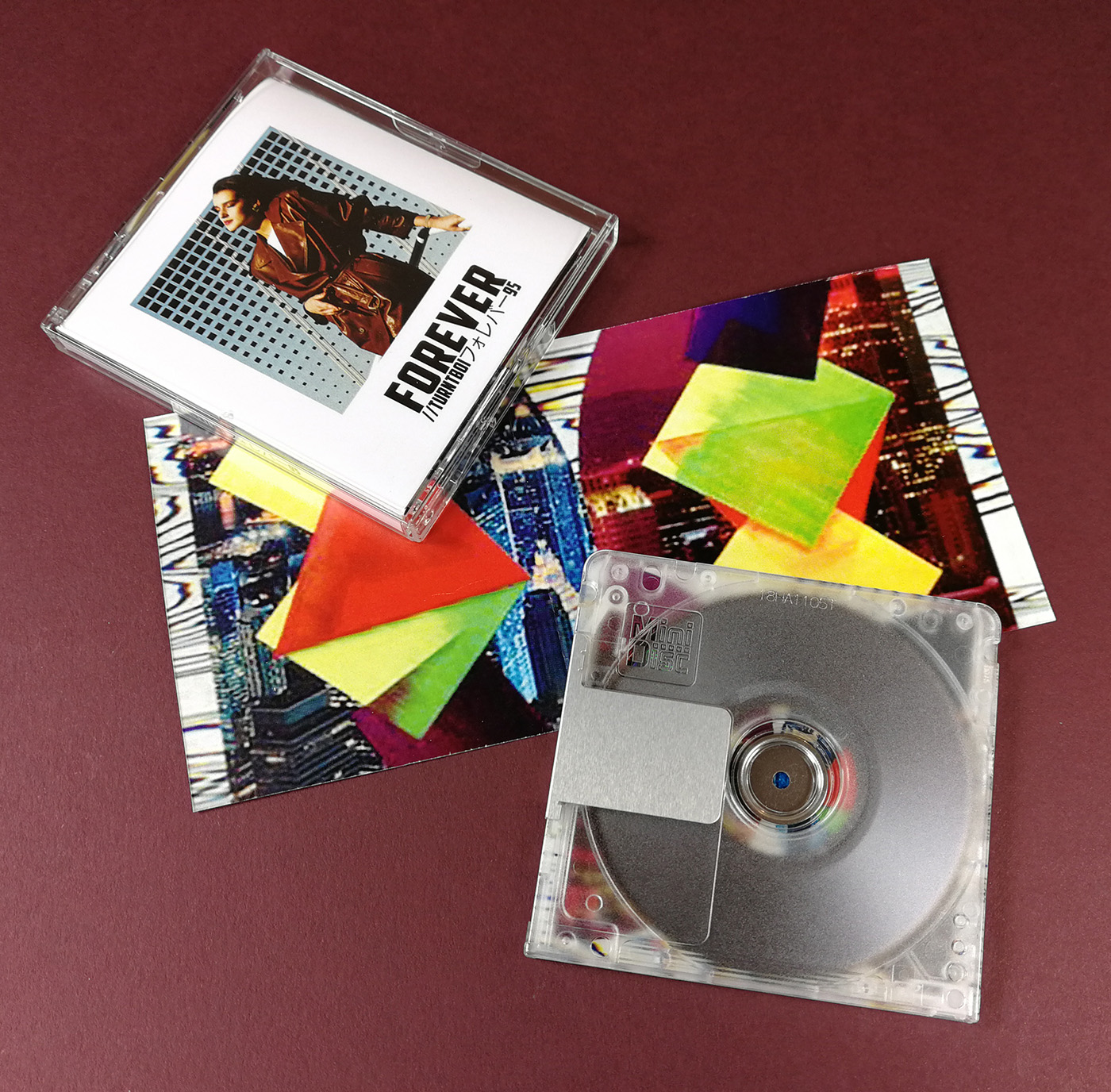 Clear MiniDiscs with jewel cases and full colour J-cards