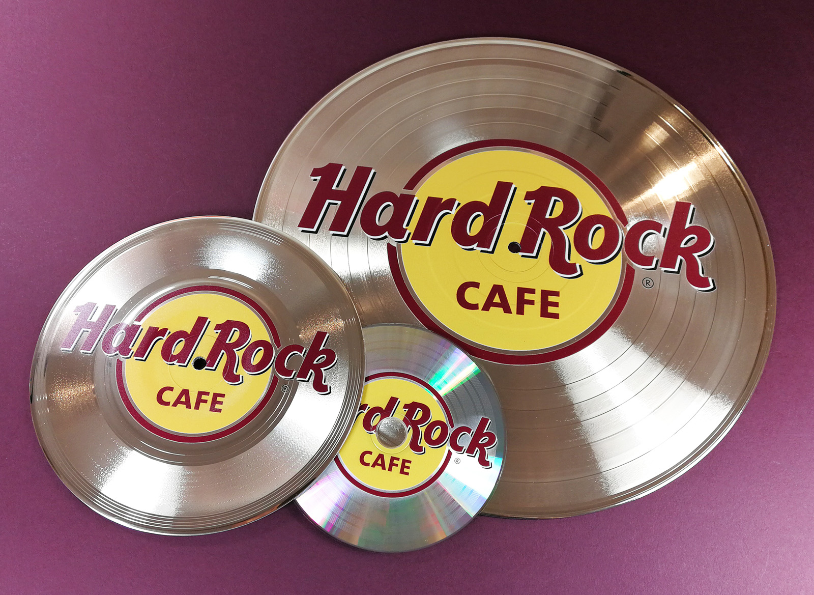"12"", 7""and 5"" silver vinyls and CDs printed with full colour on-body UV-LED printing"